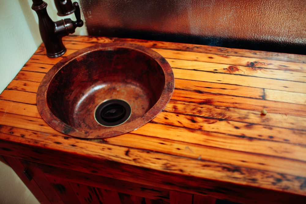 Ciderhouse bar back made from a salvaged mechanic's bench. © WildCraft Cider Works, 2014